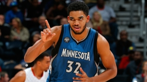 Karl-Anthony Towns has lock on the NBA's Rookie of the Year award. (Photo credit to sporting news.com)